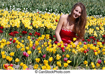 young happy woman in tulip field