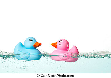 Rubber duck - Blue and pink rubber duck in the water