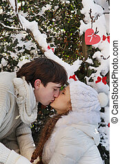 young loving couple on natural winter background