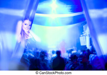 young smiling woman in night club