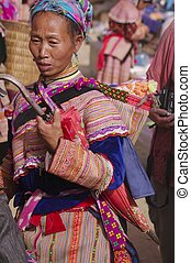 Flowered Hmong Woman with her baby - Flowered Hmong Woman....