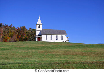 Church on the hill - Small church on top of a green hill in...