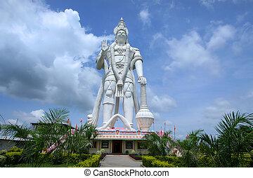 Hanuman - Huge mighty Hanuman statue against cloudy skies in...