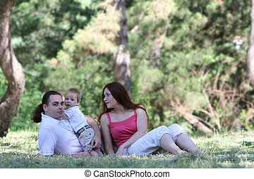 young family with child on nature