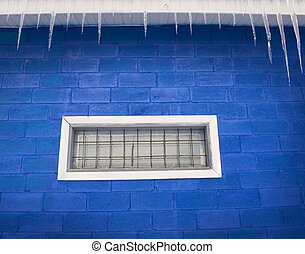Prison lattice in a window and icicles hanging down from a...