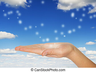 woman's hand on blue skys background
