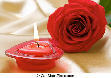 Aromatic candle and red rose
