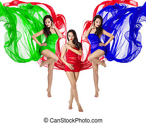 Three woman dance in red, green, blue flying dress. Over...