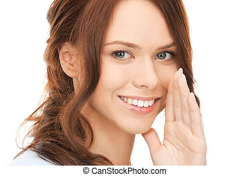 woman whispering gossip - bright picture of young woman...