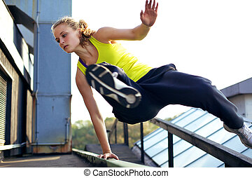 Parkour Technique Vaulting Railing - A woman traceur...