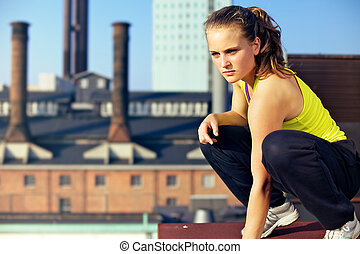 Concentrating On The Environment In Parkour - Young woman...