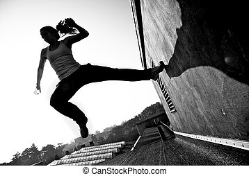 Speed In Parkour - Monochrome image of a female traceur...