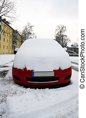 car in winter - red car in city street in winter