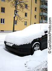 car covered with snow in winter