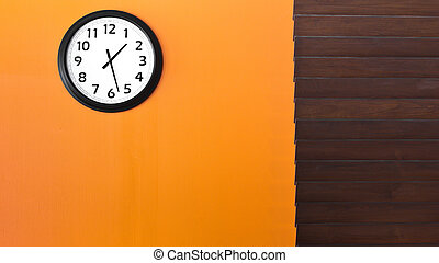 clock on the orange wall - a clock on the oange wall