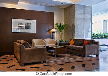 brown sofas the lobby - brown sofas and coffee table in the...