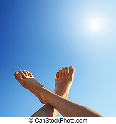 feet and sun - male and female foot high direction sky