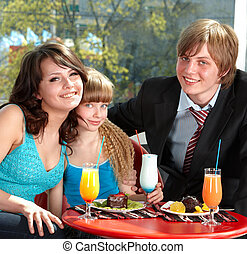 Happy family with child in restaurant Parenting