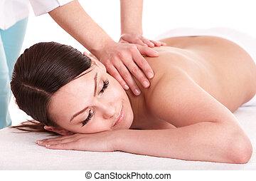 Girl having back massage. Isolated.
