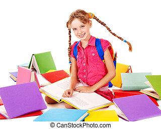 School girl holding pile of books.