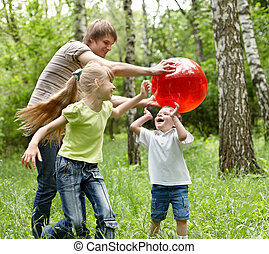 Outdoor happy family plaing ball . - Outdoor happy family...