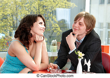 Couple on date in restaurant Flirting