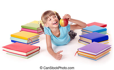 Child with pile of books reading on floor. - Child with pile...