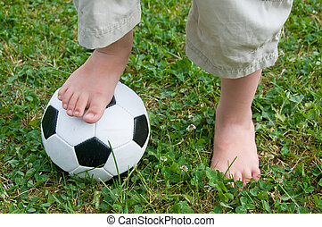 Childs Feet on a Football