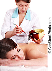Girl having chocolate mask apply by beautician. - Girl...