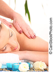 Exotic massage - A picture of a young beautiful woman having...