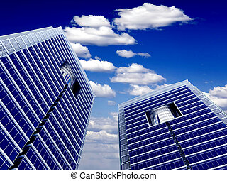 High modern skyscrapers on a background of the blue cloudy sky