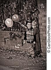 vintage shot - Cute children having a rest at a park. Retro...