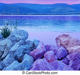 Blue purple riverbank - blue and purple stones on riverbank...