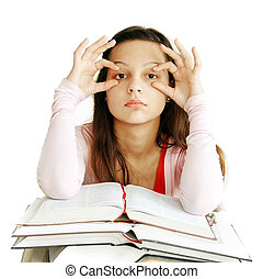 Teenage girl learning - tired caucasian teenage girl sitting...
