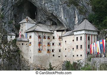 medieval Postojna castle near cave - magnificent medieval...