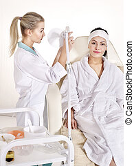 Woman on massage table in beauty spa. - Young woman on...