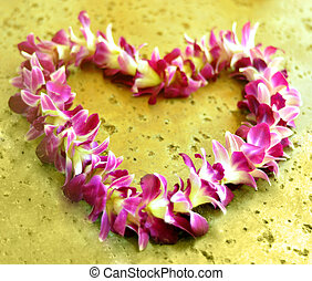 Hawaiian lei - heart shaped hawaiian lei on the stone floor