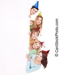 Group of people in party hat holding banner. - Group of...
