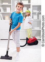Kids cleaning the room - using a vacuum cleaner