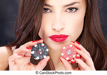 woman and gambling chips - Close up of a pretty woman...