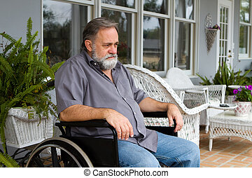 Disabled Man In Wheelchair - Depressed paraplegic man sits...