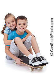 Happy kids with skateboard