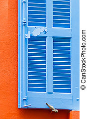 Blue window shutter - Orange building with blue window...