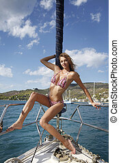 pretty young woman posing on the yacht