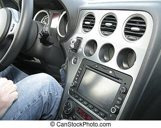 Interior car - Hand en legs in jeans in behind steering...