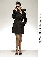 sexy brunette - attractive brunette woman wearing black coat...