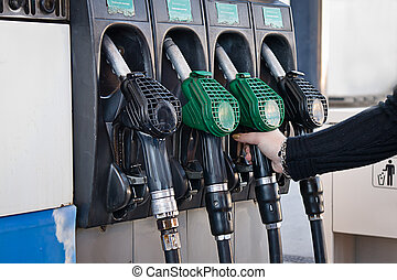 fuel station - woman in a fuel station