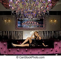 elegant blond woman in club