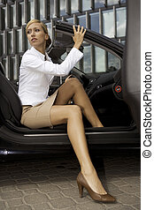 blonde businesswoman in a car - beautiful blonde...