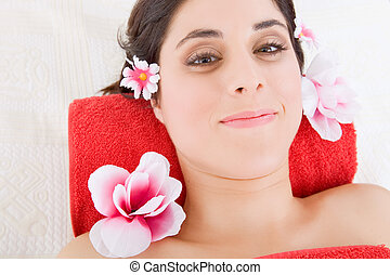 spa treatment - beautiful young woman getting spa treatment